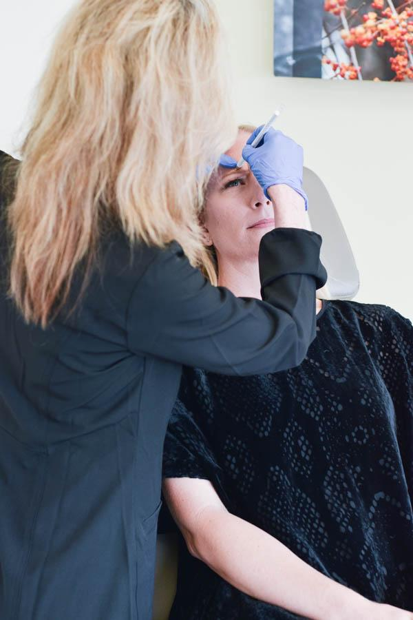 Getting Botox at CosmetiCare