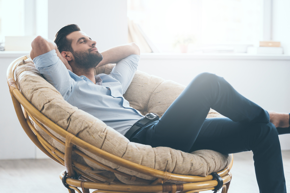 man relaxing after liposuction