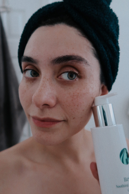 happy woman using cosmeticare medical-grade skincare products